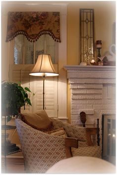 Plantation Shutters With A Fabric Valance In A Dining Room