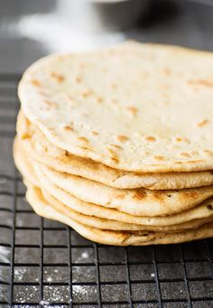 A rustic Italian flatbread, piadina, is a quick bread best served with warm salads, prosciutto or ham, fresh mozzarella and grilled veggies.