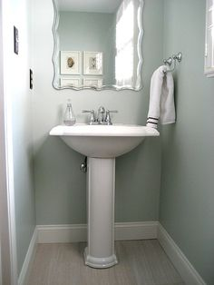 Beautiful powder room using large format 12x24 light gray tiles