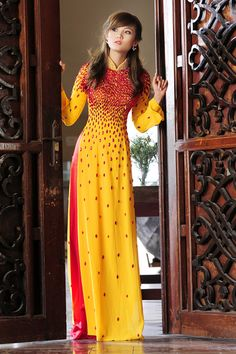 i have found i have a fetish for yellow/red ao dai...
