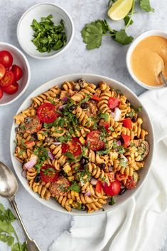 Vegan Southwest Pasta Salad Recipe | Everyone loves this vegan southwest pasta salad recipe! Made with black beans, roasted corn, tomatoes, bell peppers & an easy cashew southwest dressing. Perfect to make-ahead for parties & quick dinners. Learn how to make my EASY vegan pasta salad! #playswellwithbutter #veganpastasalad #vegan #easyvegetarianrecipe #easyveganrecipe #dairyfreerecipe #plantbased #pastasaladrecipe #coldpastasalad