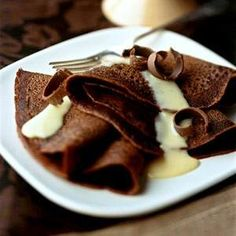 Chocolate crepes with nutmeg vanilla sauce  oh God! yesss please