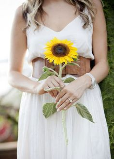 11 Remarkable Single-Flower Wedding Bouquets: You can't go wrong with a classic sunflower! They are a great way to bring bright yellows into your color palette and compliment shades from navy blue to aubergine.