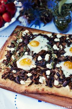 Flatbread mushroom pizza with baked egg on top.