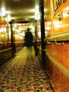 While aboard the Queen Mary a few years back my Uncle George took this picture of what he thought was an ordinary vestibule. When he got home he printed out his pictures but wasn't expecting to find what looks like a ghost walking down the hall. My Uncle is 78 and does not believe in ghosts, but this freaked him out. He doesn't even like to talk about the incident. I was just watching a special on the 10 most haunted places and when the Queen Mary was listed I felt compel