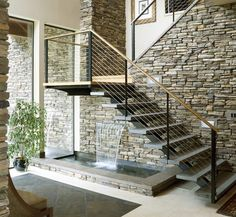 Not exactly the under-stair storage we normally try to show but interesting use of space none-the-less. I love the sound of running water but I'd want to try this in someone else's house before installing it in mine. What are your thoughts?