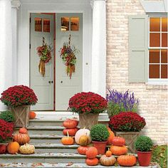 Stairs lined with mums & pumpkins | Southern Living