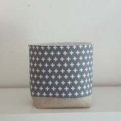 Fabric Storage Basket Grey Cross A lovely little soft storage container for keeping all your bits and bobs in. Handy to have in every room of your