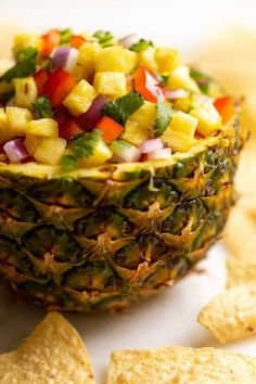 This easy pineapple salsa recipe is vibrant festive and oh-so-delicious. The citrus flavor and juicy sweet pineapple plays perfectly against the spicy addition of jalapeño for a flavor explosion you wont be able to resist! Pineapple Salsa, Fruit Salsa, Summer Party Appetizers, Incredible Recipes, Easy Appetizer Recipes, Stuffed Sweet Peppers, Salsa Recipe, Summer Recipes, Uk Recipes