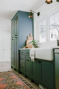 lovely farmhouse kitchen by Jaclyn Peters Design. The unusual grey green cabinets, vertical shiplap walls, the warm wood accents especially at the end of the island, the wide white oak floorboards and black accents. Layout Design, Küchen Design, Ikea Hacks, Dining Room Curtains, Black Granite Countertops, Green Cabinets, White Cabinets, Kitchen Cabinets, Green Kitchen