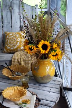 Sunflower accents are perfect for a porch table.
