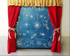 Another view: Winter Season Bulletin Board designed by Sandra and Lori for our Pre-K board....inside the window / the childrens wonderful art work. Q-tip snow flakes.  Curtains made from Felt, tied back with plaid Ribbon and the Valance made from Felt with coordinating ribbon strung through. Brown felt for window sill.