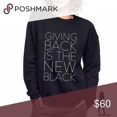 Giving Back Unisex Sweatshirt in Black For each sweatshirt sold, 7 meals are given to children in need. Classic pullover sweatshirt in comfy super soft fleece designed for warmth and breathability. Features on trend drop shoulder seam and unisex retail fit. Finished with ribbed cuffs and waistband. 60% combed and ring-spun cotton and 40% polyester fleece. xs-xl Half United Tops Sweatshirts & Hoodies
