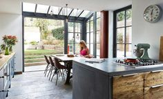 a glazed kitchen extension with Crittal-style windows and industrial touches