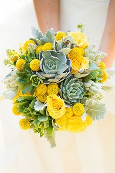 For summer's garden weddings, wildflower bridal bouquets generally dominate. Make your wedding bouquet stand out by adding succulents to your billy balls and yellow roses.
