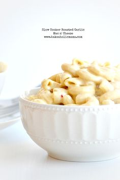 Bakeaholic Mama: Slow Cooker Roasted Garlic Mac n' Cheese. Hounds down, this sounds like the best version of crock pot mac and cheese ever.  I'm totally going to have to try this.