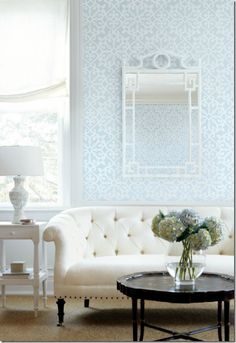 loveeee the combination of a soft wall paper pattern and white tufted furniture...bedroom ideas!