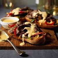 Open-Face Philly Cheesesteak Sandwiches - These were excellent! I had no idea homeade cheeze sauce was so easy!