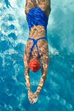 1904641-athletic-swimmer-is-diving-in-a-swimming-pool.jpg (801×1200)