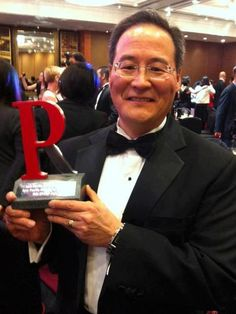 Glenn Osaki, President, MSLGROUP Asia, with the Campaign Asia 'APAC PR Network Of The Year' award