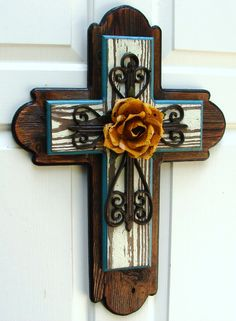 Brown/white/turquoise stacked wooden cross with yellow metal rose.  $85.00