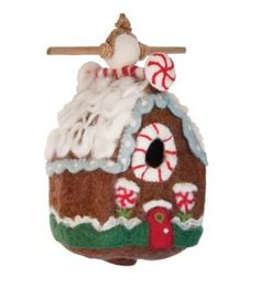Our Gingerbread Chalet Felt Bird House is handmade by skilled artisans in a fair trade center in Kathmandu, Nepal. It's made with soft wool, and can be hung as an indoor or outdoor decoration!