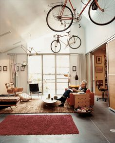 A living room with a Robsjohn-Gibbings chaise and Frank Gehry Power Play club chair.
