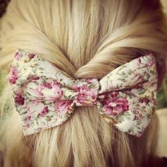 Half up do with a bow to complete the look