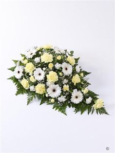Carnation and Germini Spray - Yellow and White. This classic teardrop spray features soft lemon carnations and snow white germini. Tiny white gypsophila flowers and intricate leather leaf foliage give this arrangement extra detail. Funeral Floral Arrangements, Church Flower Arrangements, Funeral Flowers, Wedding Flowers, Casket Sprays, Memorial Flowers, Leather Leaf, Sympathy Flowers, Gypsophila