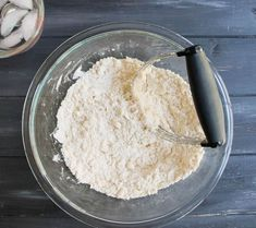 Cutting diced butter into flour to make Easy All Butter Pie Crust from themerchantbaker.com