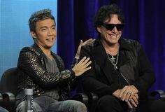 """Arnel Pineda, left, and Neal Schon of the rock band Journey take part in a panel discussion on the Independent Lens documentary """"Don't Stop Believin': Everyman's Journey,"""" at the PBS Summer 2013 TCA press tour at the Beverly Hilton Hotel on Tuesday, Aug. 6, 2013, in Beverly Hills, Calif."""