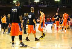 Southland Sharks' Leon Henry, Andrew Wheeler and Luke Martin watching the dancers hogging the court at half time - they didn't join in though? Stadium Southland, June Southland Sharks v Otago Nuggets. Shark S, Park Hotel, Dancers, June