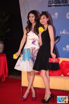 Hong Kong actress Fiona Sit and Taiwanese actress Ivy Chen pose at a press conference for their new movie 'Girls' in Beijing, China, April 17, 2014
