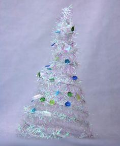 Miniature cone shaped tree for a Christmas village made from wired tinsel
