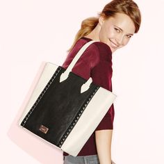 Loving this look: A black and white tote bag with covered studs? Yes please! #AvonRep