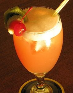 Jamaican Me Crazy (1 oz. Rum (clear)  1 oz. Malibu Coconut Rum  1 oz.Banana Liqueur  3 oz. Pineapple Juice  3 oz. Cranberry Juice  Cherry and/or Banana Slice and/or Kiwi Slice for garnish)