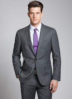 Nice classic cut business suit. Tie is exceptional.