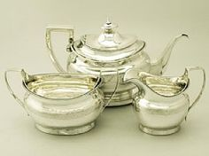 A fine antique George III English sterling silver three piece tea service with matching teapot stand / set; part of our silver teaware collection  http://www.acsilver.co.uk/shop/pc/Sterling-Silver-Three-Piece-Tea-Service-with-Matching-Tea-Pot-Stand-Antique-George-III-67p3642.htm