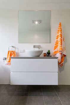 Grey floor tiles, white wall tiles, white floating vanity with grey stone bench top styled with towels from Sunday Minx. Stone Bathroom, Bathroom Renos, White Bathroom, Bathroom Renovations, White Wall Tiles, Grey Floor Tiles, Grey Flooring, Stone Bench, Floating Vanity