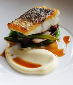 Escalope of wild sea bass with sautéed smoked bacon, red chicory, runner beans . Escalope of wild sea bass with sautéed smoked bacon, red chicory, runner beans and red wine sauce Fish Recipes, Seafood Recipes, Gourmet Recipes, Cooking Recipes, Gourmet Desserts, Gourmet Foods, Plated Desserts, Great British Chefs, Think Food
