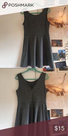 Heathered gray H&M dress Deep v back. Stretchy and cute. Dark grey heathering. Never worn. Excellent condition. US size 14. H&M Dresses Mini