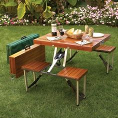 Why have your picnic on the grass when you can carry a suitcase that gets you a table and four chairs? No, really, the Tailgate Folding Wooden Picnic Table does Foldable Picnic Table, Wooden Picnic Tables, Folding Picnic Table, Outdoor Tables, Outdoor Dining, Outdoor Decor, Patio Tables, Outdoor Gifts, Outdoor Events