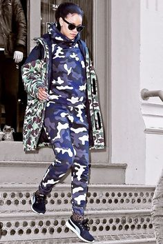Rihanna Sees Your Double Denim, Raises You Camo #refinery29  http://www.refinery29.com/2015/03/84227/rihanna-camouflage-sweats-outfit