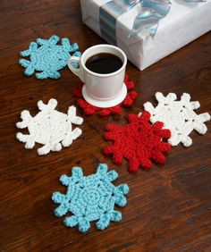 Snowflake Coasters. I am going to use a smaller yarn and do some as ornaments. Possibly adorned with beads and wire crafted thingies.