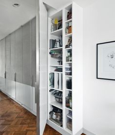 """Restricting storage to a monolithic bank of bookshelves and cabinets cuts down on furniture clutter. """"If you put a lot of small things in..."""