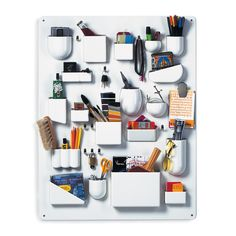 Keep your home organised with this Uten Silo wall storage from Vitra. Crafted from ABS plastic, this crisp white storage unit features containers of different shapes and sizes & is perfect for hold...