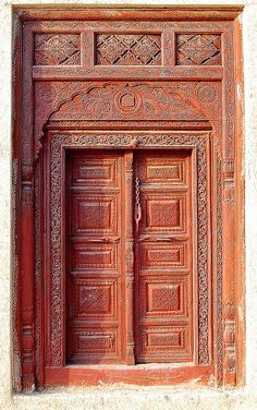 The Moghul Door, Lok Virsa, Islamabad  The typical Moghul entrance door with carving and motifs. These type of doors are still being produced in Pakistan and sold for bungalows and commercial shops.
