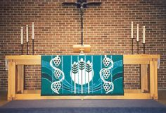Karissa--it would be cool if we could have something beautiful that was seasonal to hang off the communion table....