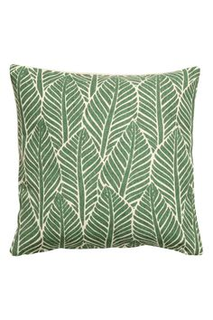 Leaf-print cushion cover: Cotton cushion cover with a leaf print on the front and solid colour back. Concealed zip.