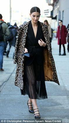 Model Lily Aldridge, 29, looks demure in just one item of leopard print...